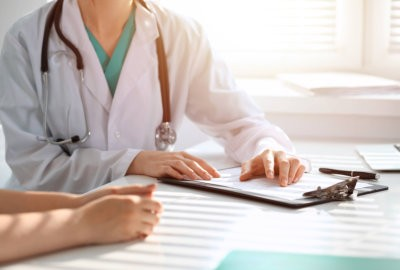 crop image of a doctor holding a document